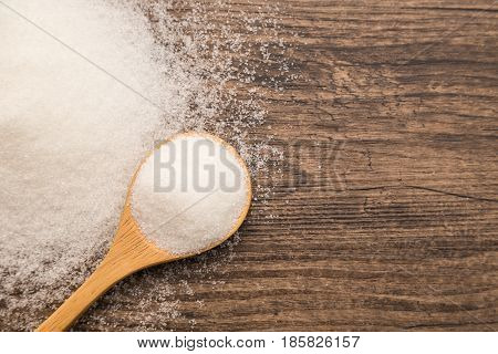 Pile Of Sugar On Wooden Plank Background. Use For Diabetes Check Up Concept