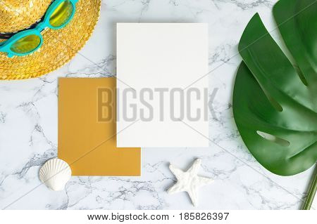Blank White And Gold Paper Card On Marble Table Top View With Summer Beach Accessories And Shell,sta