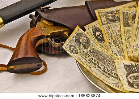 Civil War pistol, sword and Confederate bills