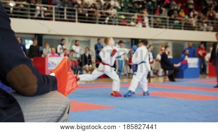Karate - judge coaches looking at teenager's karate fighting, close up