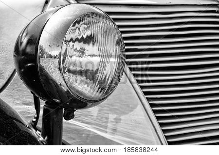 PAAREN IM GLIEN GERMANY - MAY 19: Headlamp car Ford Eifel (black and white) The oldtimer show in MAFZ May 19 2013 in Paaren im Glien Germany