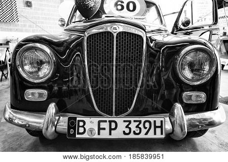 PAAREN IM GLIEN GERMANY - MAY 19: Small family car Lancia Appia Berlina 1st series (1953) black and white