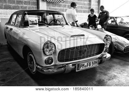 PAAREN IM GLIEN GERMANY - MAY 19: Small family car Lancia Appia 3rd series black and white