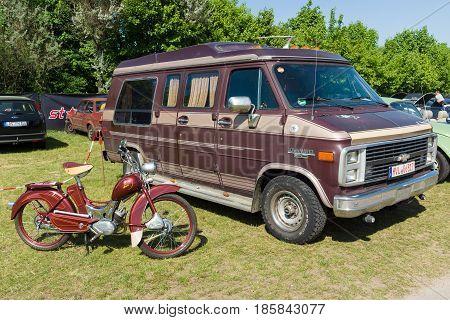 PAAREN IM GLIEN GERMANY - MAY 19: Full-size van Chevrolet Van G20 and moped Simson SR2