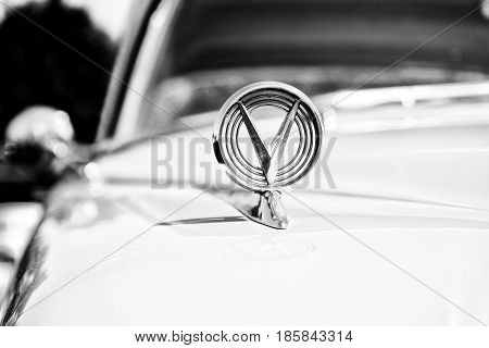PAAREN IM GLIEN GERMANY - MAY 19: Hood ornament and insignia personal luxury car Buick Series 700 Limited Hardtop Sedan (1958) black and white The oldtimer show in MAFZ May 19 2013 in Paaren im Glien Germany
