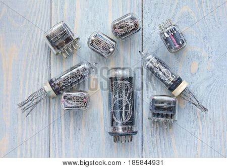 Different tipes of nixie tubes on wooden background.