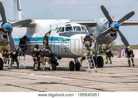 Kiev Region Ukraine - April 24 2012: Special counter-terrorist forces train to rescue the hostages and assault the plane captured by the terrorists