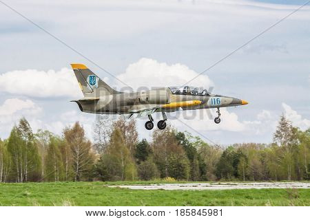 Kiev Region Ukraine - April 24 2012: Ukraine Air Force Aero L-39 Albatros trainer plane landing on the runway after another flight