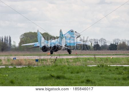 Kiev Region Ukraine - April 24 2012: Ukraine Air Force Aero MiG-29 jet fighter is taking off from the airbase for another flight on cloudy day
