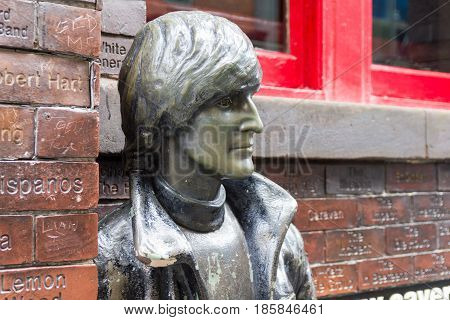 LIVERPOOL, ENGLAND - APRIL 3, 2017: John Lennon statue in front of the Cavern Pub. The sculpture was unveiled on 16 January 1997 outside the pub located in front of the Cavern Club.