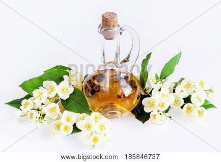 Jasmine oil concept spa with jasmine flowers on a white background. Aromatherapy