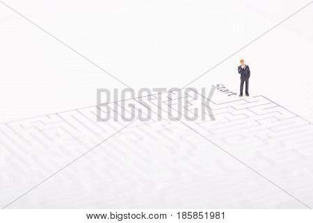 Businessman entering in maze on white background