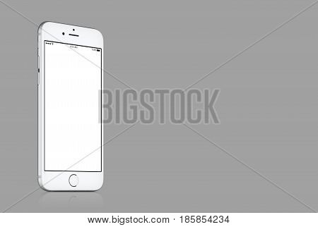 Varna, Bulgaria - March 10, 2016: Silver Apple iPhone 7 mockup with white blank screen on solid gray background with copy space for your design. High quality studio shot.
