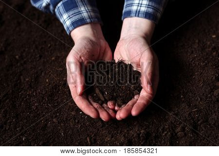 Female farmer handful of soil sustainable resources and organic agricultural production