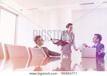 Cropped image of businesswoman using copy machine in office