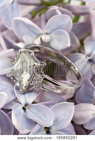 Ring with big diamond on violet flower