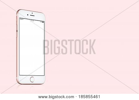 Varna, Bulgaria - March 10, 2016: Rose Gold Apple iPhone 7 mockup with white blank screen on solid pink background with copy space for your design. High quality studio shot.
