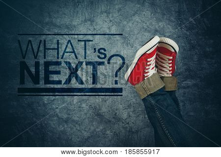 What's next concept with young person in casual sneakers making plans and setting goals youth lifestyle and unpredictable future