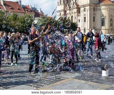 Prague Czech Republic - September 23 2016: unidentified having fun with soap bubbles at Old Town Square.