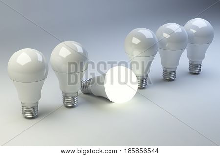 Row of LED light bulbs with one different from the others. 3d illustration high resolution.
