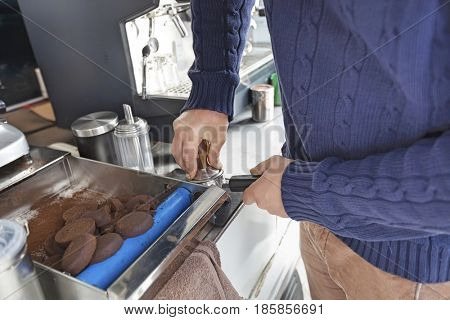 Midsection of man preparing coffee at mobile coffee shop