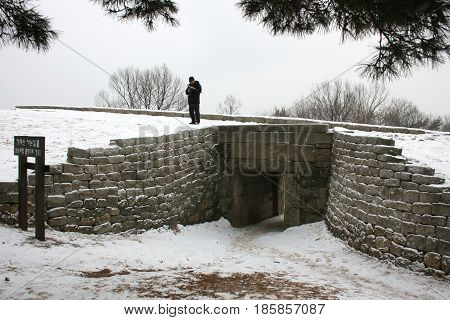 Sangdangsanseong, Cheongju, South Korea - February 16, 2011:  Stone wall with a gate of the fortress.  -February 16, 2011 - Sangdangsanseong, Cheongju, South Korea