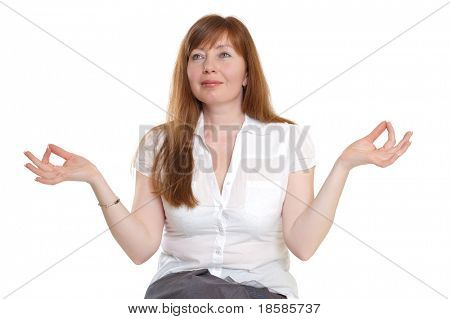 red-haired woman meditating on a white background