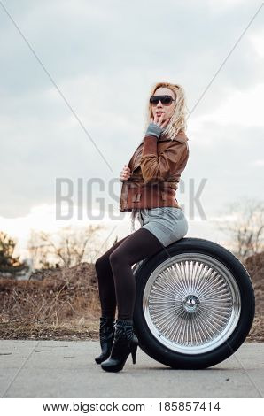 Sexy Young Girl Sits On A Large Wheel