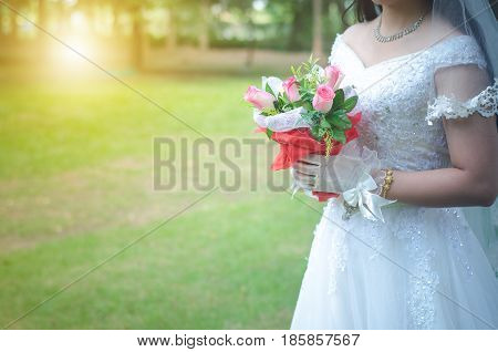 Weding in park with golden light in the morning