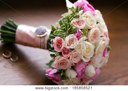 Wedding bouquet and rings. The concept of marriage and love. accessories marriage closeup.