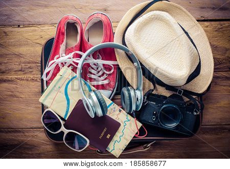 Travel accessories and costume on luggage prepare for trip