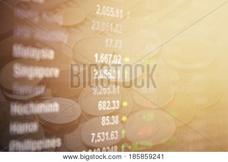 Business or finance background concept : Financial Asia Pacific stock exchange market board on coins background