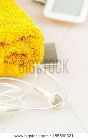 headphones mp3 player and orange towel symbols of modern lifestyle sport fitness activities