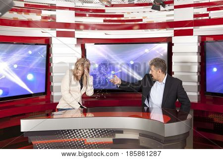 Conflict in the television studio during live broadcasting