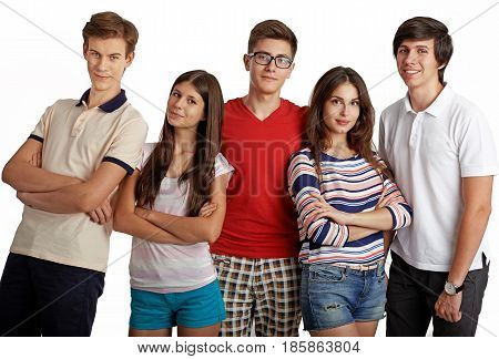 Portrait of stylish team of classmates posing in studio over white background. Diversity of handsome Caucasian people in casual clothes smiling looking at camera. Teamwork, college, education concept.