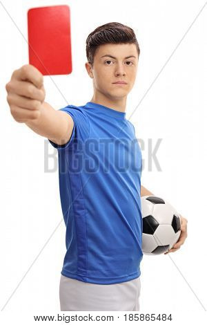 Teenage soccer player showing a red card isolated on white background