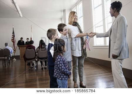 Politician greeting mother and children at political gathering