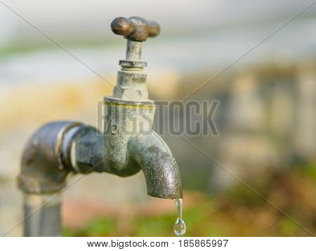 Close up old and grunge faucet and water drop Water shortage concept.