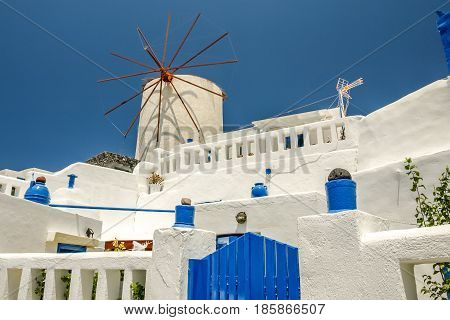 view of oia in santorini with an old mill