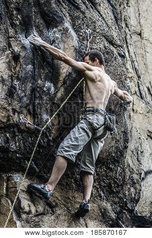 Sokoliki Poland june 23 2013: Young male climber leading a route on a rock. Sokoliki Poland