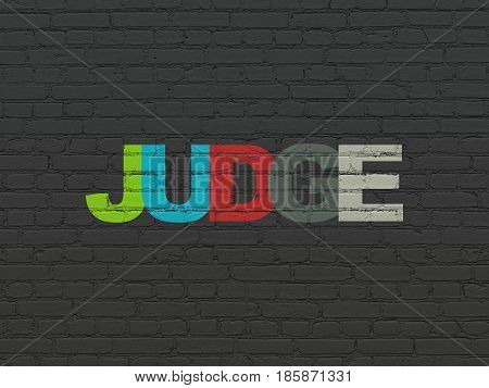 Law concept: Painted multicolor text Judge on Black Brick wall background