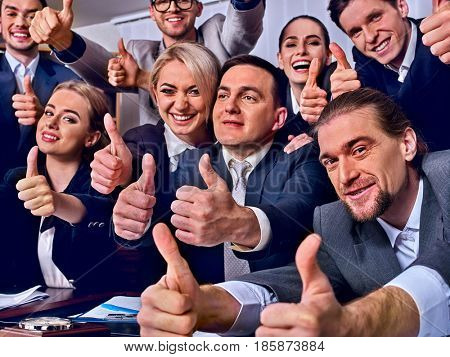 Business people office life of team people happy sitting table . People in business suits are happy from successful deal and wish success to everyone around them and gesture show thumb up.