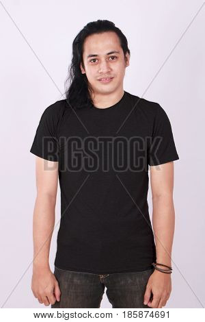 Photo image of an Asian Model smiling and showing blank black T-Shirt front view shirt template