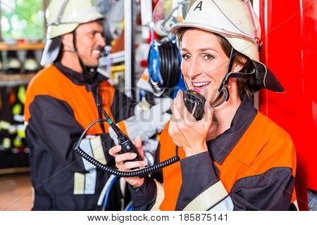 Chief of fire department  checking radio connection
