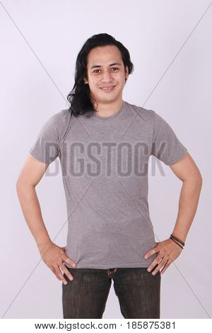 Photo image of an Asian Model smiling and showing blank grey T-Shirt front view shirt template