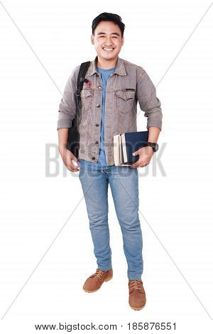 Photo image portrait of a cute young Asian male student standing looking at camera and smiling while holding some books full body portrait isolated on white