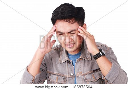Photo image portrait of a young Asian man looked suffered of headache pain with eyes closed touching his forehead with his finger isolated on white