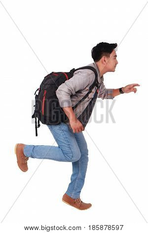 Photo image portrait of a young Asian male student running forward side view isolated on white