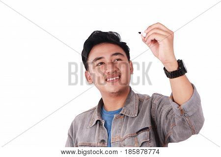 Photo image portrait of a cute young Asian male student standing and writing empty blackboard copyspace isolated on white
