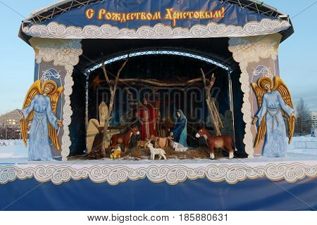 PERM RUSSIA - JAN 18 2017: Depiction of Nativity of Jesus Christmas decoration in Perm Ice Town 2017 Ekosad - largest in Russia Text - Christmas